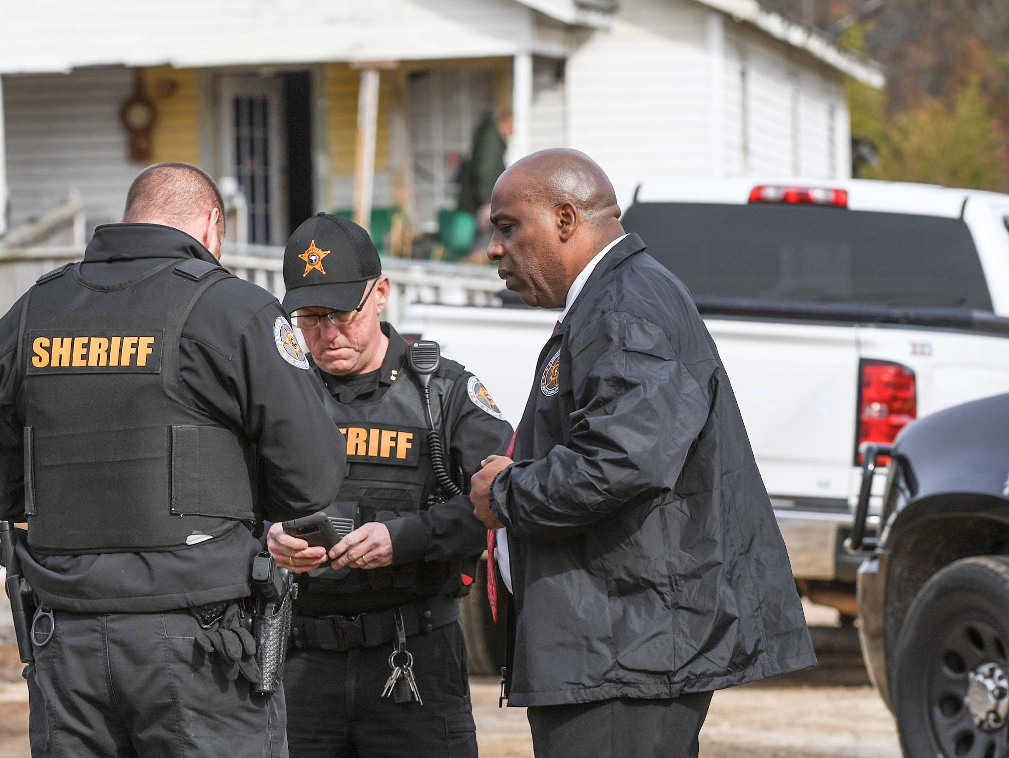 Anderson County Sheriff Capt. Darrell Hill, right, speaks with others who responded to Brazeale Street in Belton after a report that a man struck an officer serving a warrant at a house Wednesday, December 12, 2018.
