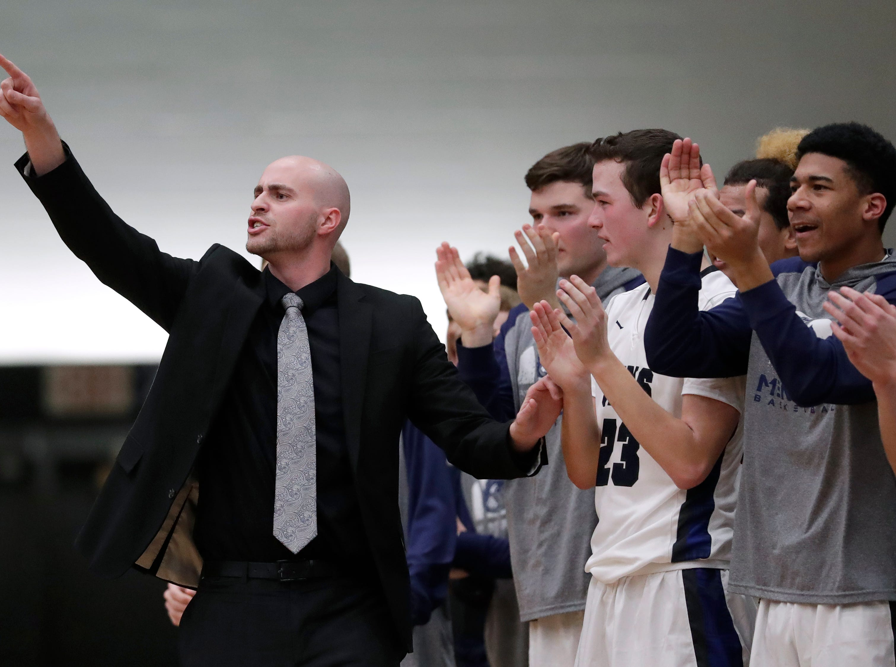 Menasha High School's head coach Sam Koslowski directs his players against West De Pere High School during their boys basketball game Tuesday, December 11, 2018, in Menasha, Wis. Dan Powers/USA TODAY NETWORK-Wisconsin