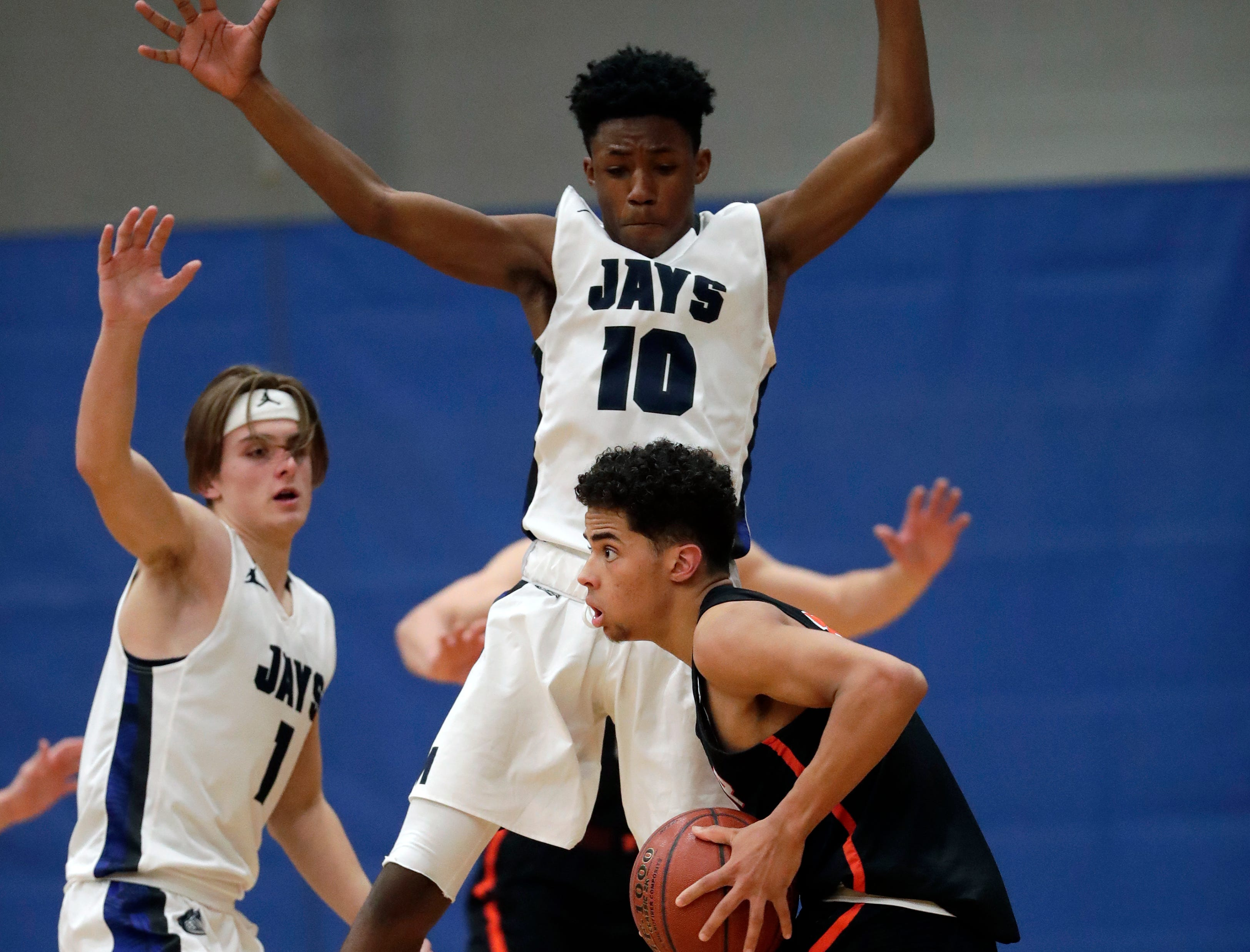 Menasha High School's Jalen Womack (10) defends against West De Pere High School's Jovan Webb (14) during their boys basketball game Tuesday, December 11, 2018, in Menasha, Wis. Dan Powers/USA TODAY NETWORK-Wisconsin