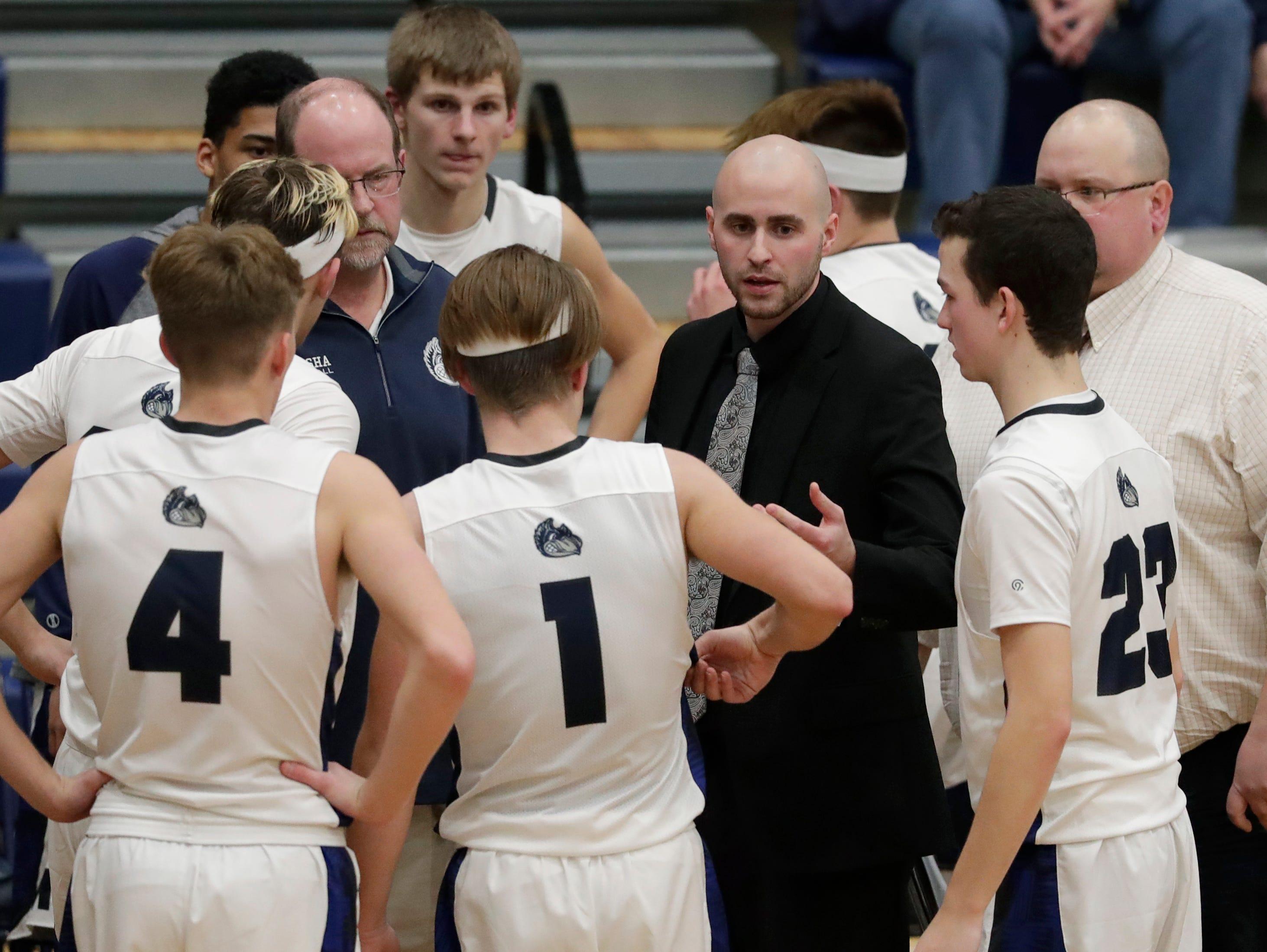 Menasha High School's coach SamKoslowski leads his team against West De Pere High School during their boys basketball game Tuesday, December 11, 2018, in Menasha, Wis. Dan Powers/USA TODAY NETWORK-Wisconsin