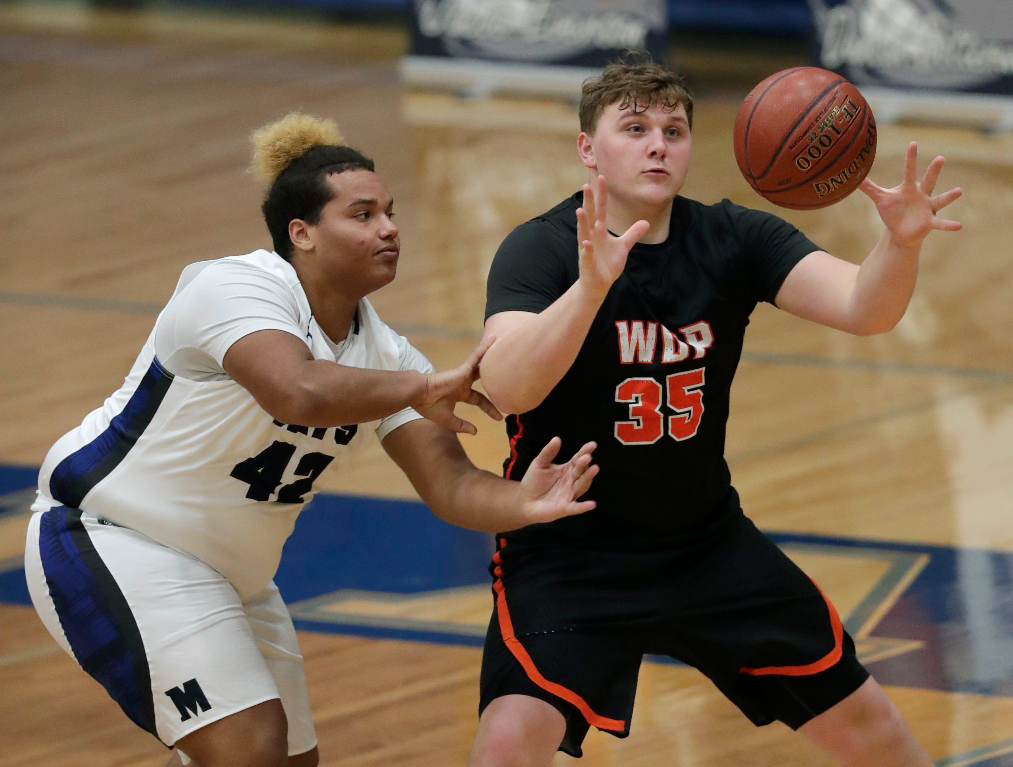 Menasha High School's Eli Williams (42) defends against West De Pere High School's Kerry Kodanko (35) during their boys basketball game Tuesday, December 11, 2018, in Menasha, Wis. Dan Powers/USA TODAY NETWORK-Wisconsin