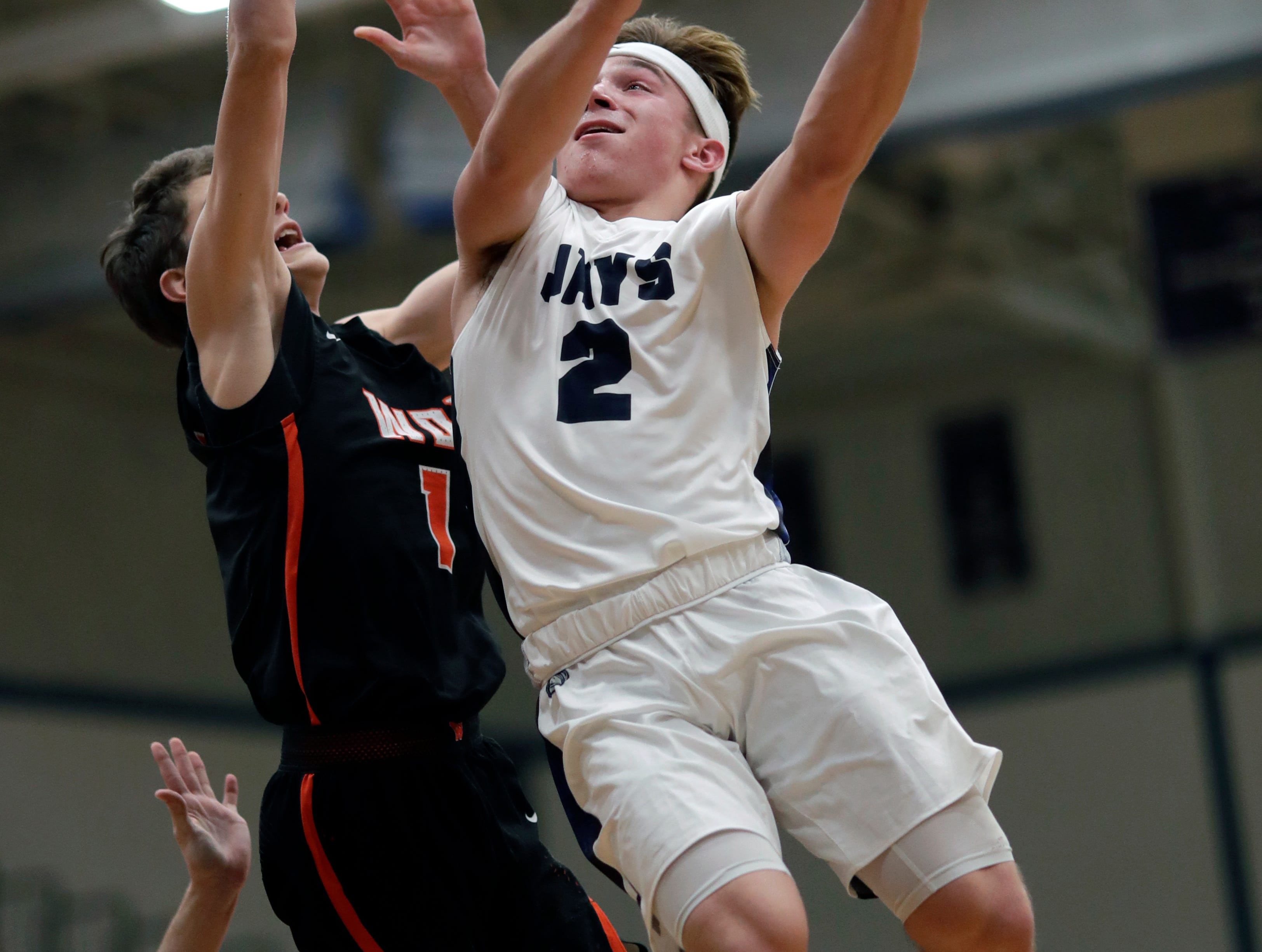 Menasha High School's Tristin DeBryin (2) drives to the basket against West De Pere High School's Nate Jensen (1) during their boys basketball game Tuesday, December 11, 2018, in Menasha, Wis. Dan Powers/USA TODAY NETWORK-Wisconsin