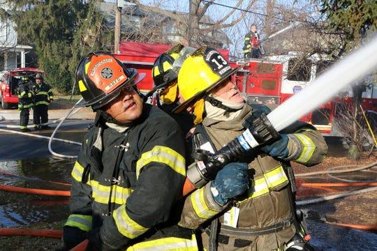 Firefighters battle Red Bank blaze