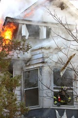 Firefighters tackle the blaze at 28 Rector Place in Red Bank on Dec. 12, 2018
