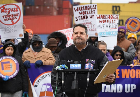 Alberto Arroyo, Co-Manager of Laundry Distribution and Food Service Joint Board, Workers United SEIU, speaks during a press conference at the Port of Newark to call for greater protections for warehouse workers, photographed at the corner of Corbin and Marsh streets in Newark on 12/12/18.