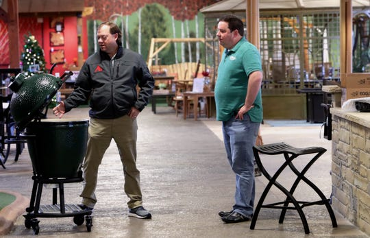 Brad Schweig, right, co-owner of Sunnyland Furniture looks on as a smoker is examined in Dallas.
