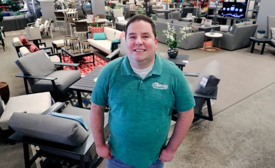 Brad Schweig, co-owner of Sunnyland Furniture, poses for a photo at his store in Dallas.