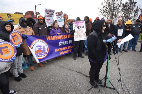 Maricarmen Molina of Paterson who works at Distribution Warehouse called GIII Apparel, speaks during a press conference at the Port of Newark to call for greater protections for warehouse workers, photographed at the corner of Corbin and Marsh streets in Newark on 12/12/18.