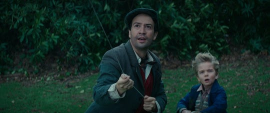 "Lin-Manuel Miranda, left, stars as Jack who jumps in to help Georgie Banks (Joel Dawson) in Disney's original musical ""Mary Poppins Returns,"" a sequel to the 1964 ""Mary Poppins"" which takes audiences on an entirely new adventure with the practically-perfect nanny and the Banks family."