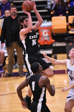 Abilene High's Brian Patton (20) puts up a shot in a nondistrict game against Wylie at Bulldog Gym on Tuesday, Dec. 11, 2018. The Eagles pulled out a 52-49 win.