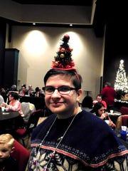 Leah O'Brien, a member of South Pointe Church, enjoys the fun of a community Christmas celebration at the church.