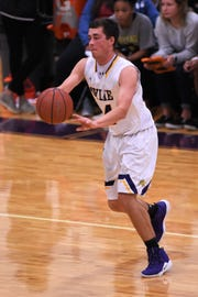 Wylie guard Duncan Bacon (24) passes the ball in a nondistrict game against Abilene High at Bulldog Gym on Tuesday, Dec. 11, 2018. The Eagles pulled out a 52-49 win.