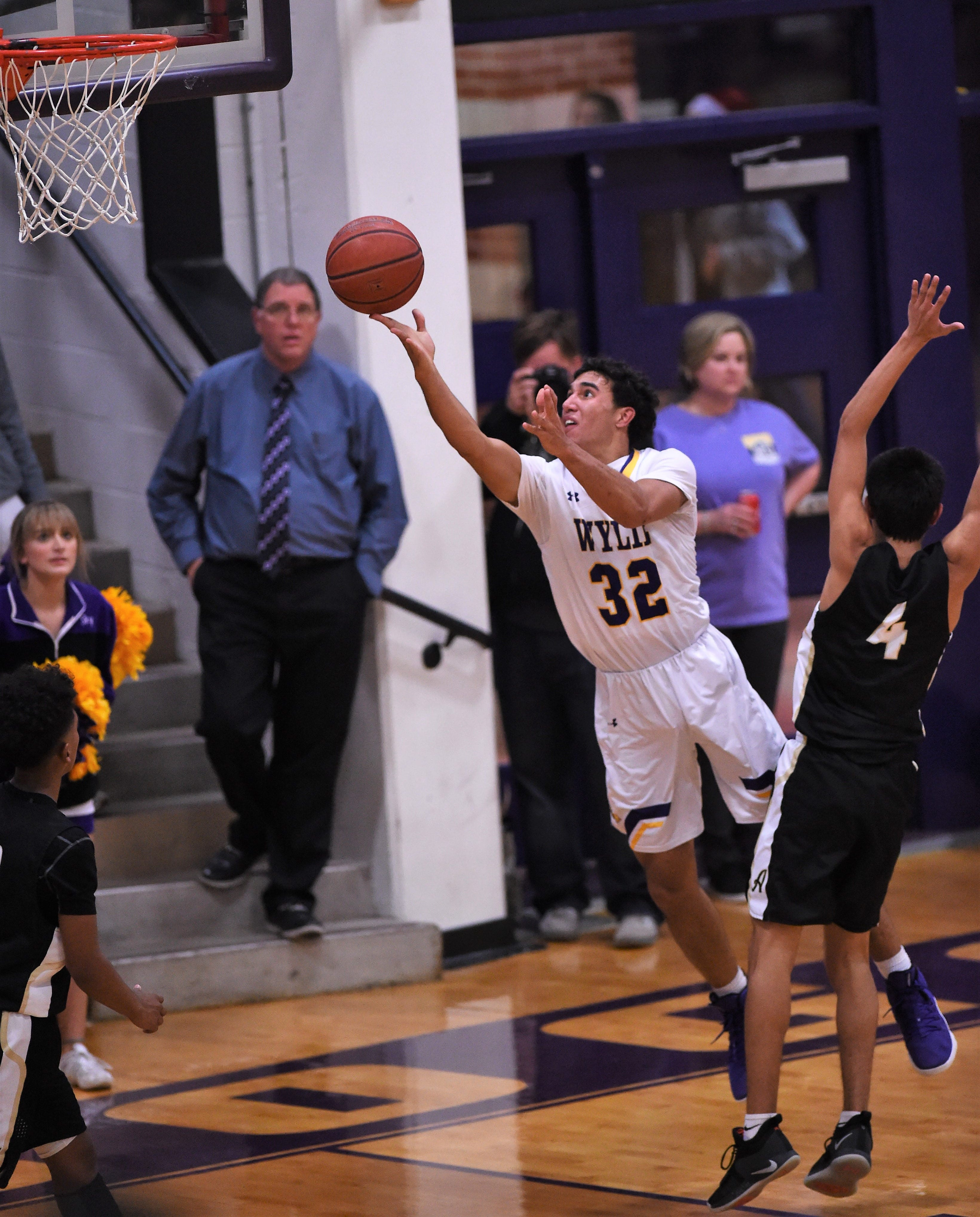 Wylie's Payton Brooks (32) puts up a shot around an Abilene High defender in a nondistrict game at Bulldog Gym on Tuesday, Dec. 11, 2018. The Eagles pulled out a 52-49 win.