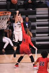 Abilene Georgia Montes (12) takes a 3-point shot in the District 3-6A opener against Euless Trinity at Eagle Gym on Tuesday, Dec. 11, 2018.