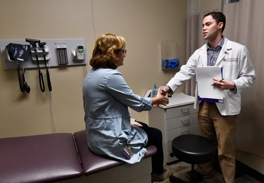 Ryan Comeaux, a physician assistant student, shakes hands with assistant professor Kathy Robinson at the end of his Objective Structured Clinical Examination Wednesday. Robinson role-played as a patient to evaluate Comeaux's effectiveness in communicating medical information.