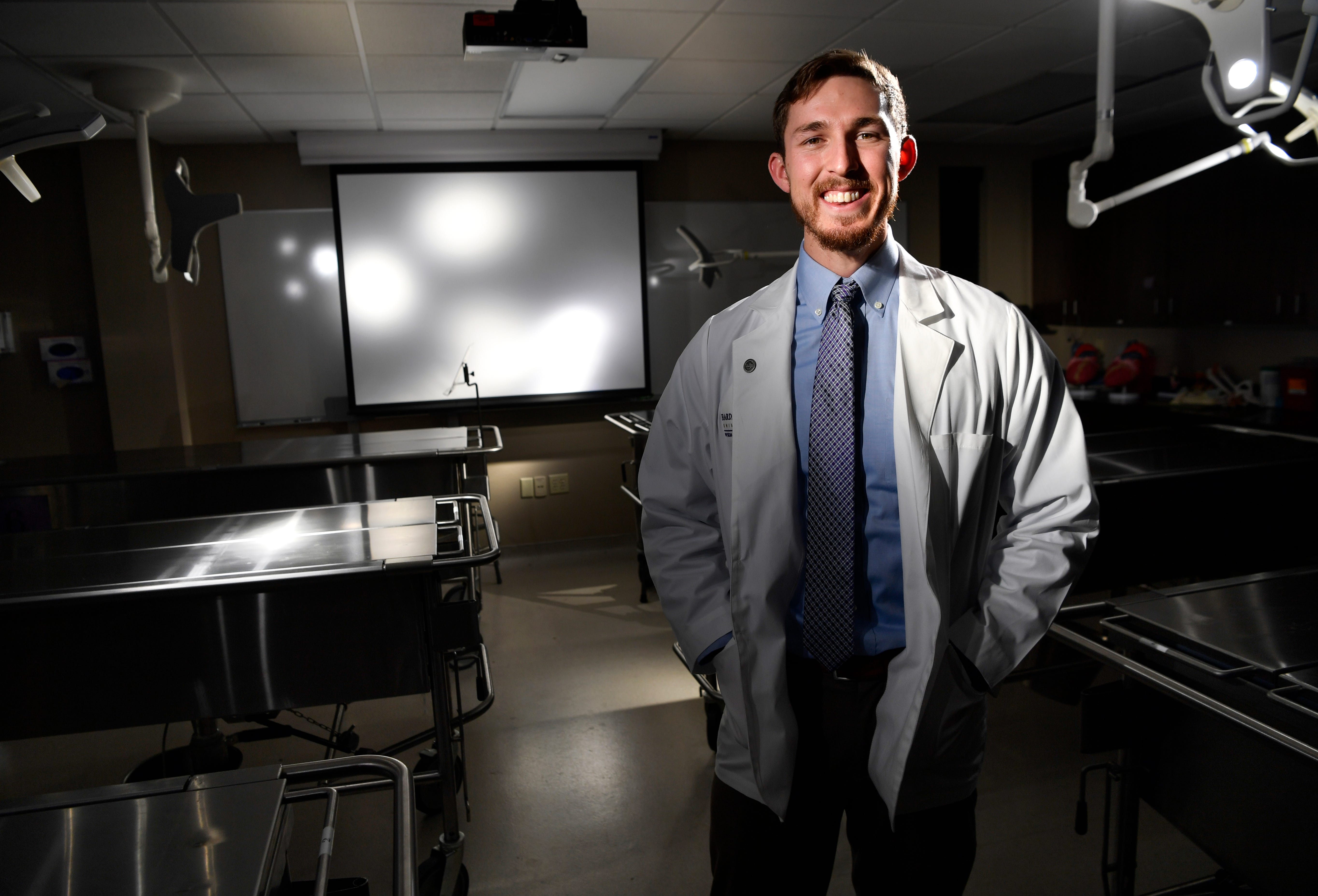 Darby Thornton is lit by the examination lights in the physician assistant program's anatomy lab Wednesday at Hardin-Simmons University.