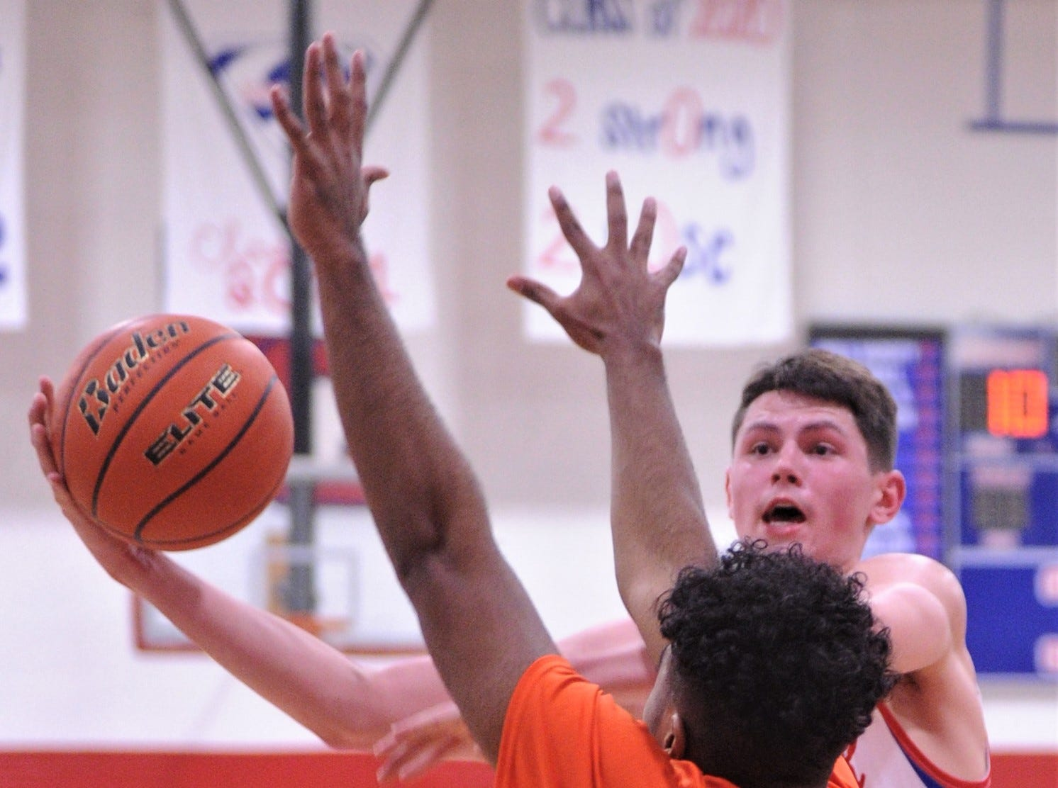 Cooper's Devin Bailey drives to the basket as Burkburnett's Daunte Thompson defends. Burkburnett won the game 89-76 on Tuesday, Dec. 11, 2018, at Cougar Gym.