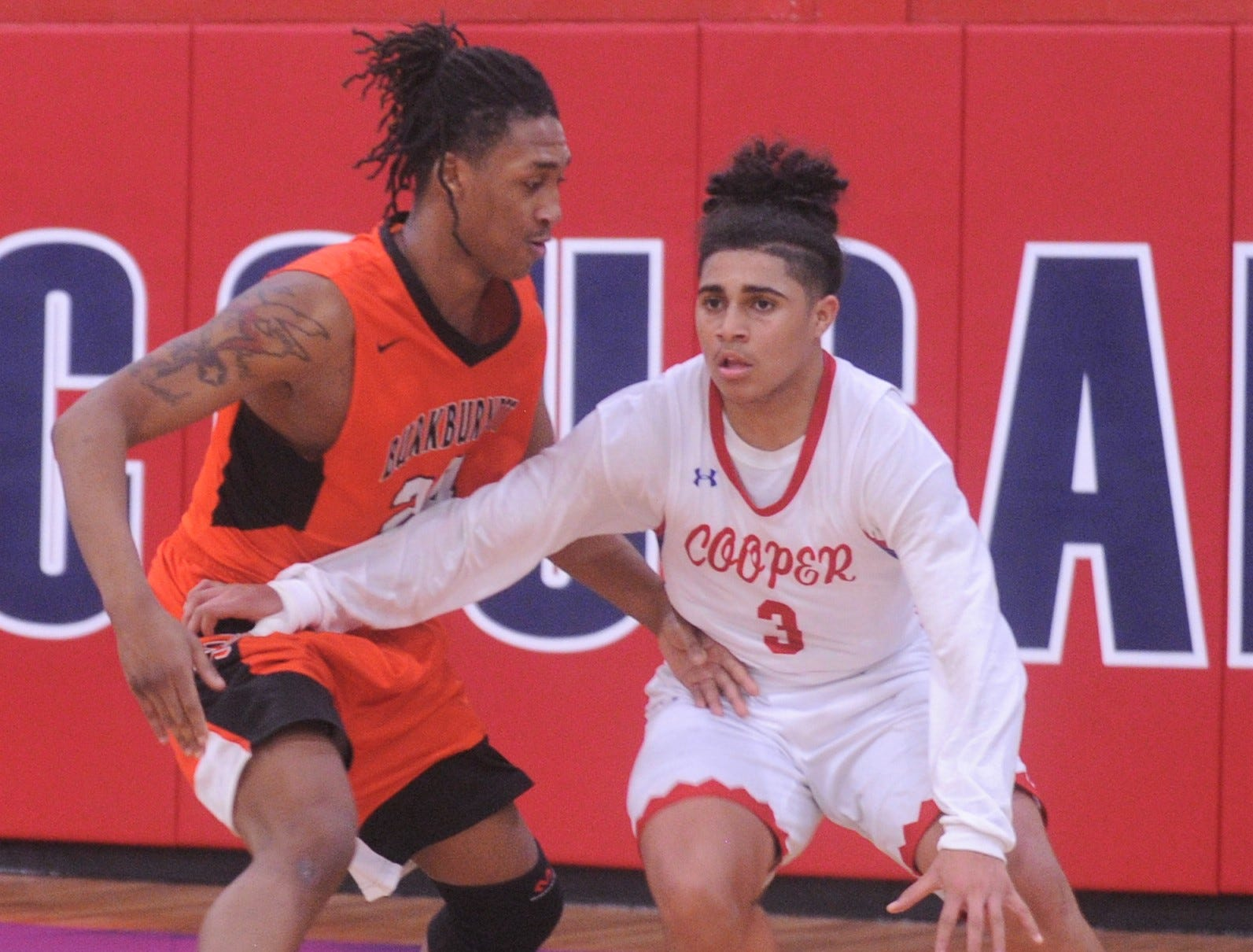 Cooper's Noah Garcia, right, tries to get past Burkburnett's Lucas Prayer as he tries to bring the ball upcourt. Burkburnett won the game 89-76 on Tuesday, Dec. 11, 2018, at Cougar Gym.
