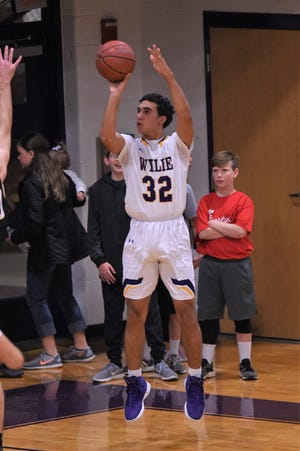 Wylie's Payton Brooks (32) takes a 3-pointer in a nondistrict game against Abilene High at Bulldog Gym on Dec. 11. The Eagles pulled out a 52-49 win.