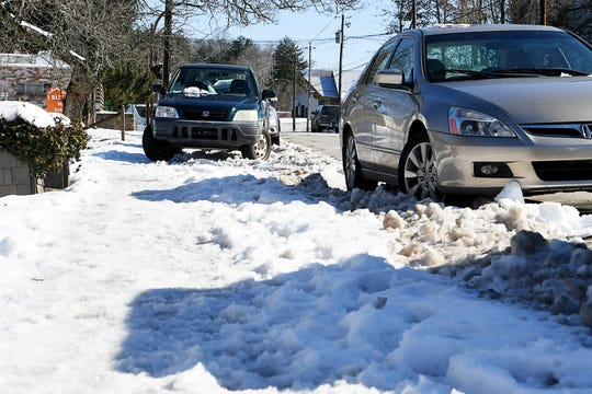 Sidewalks in West Asheville were covered with snow and ice Dec. 11, 2018.