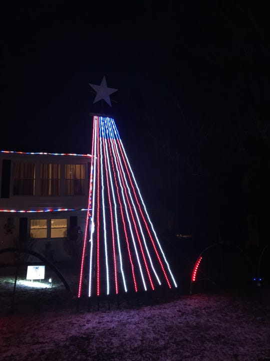 "A light show set to ""God Bless the U.S.A"" is one of the most popular sections of a show held outside 108 Sandy Drive in Vestal."