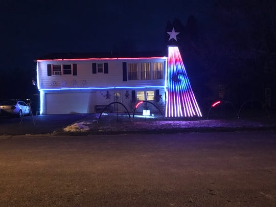 A musical light show held outside 108 Sandy Drive in Vestal features a patriotic tribute to the Armed forces.
