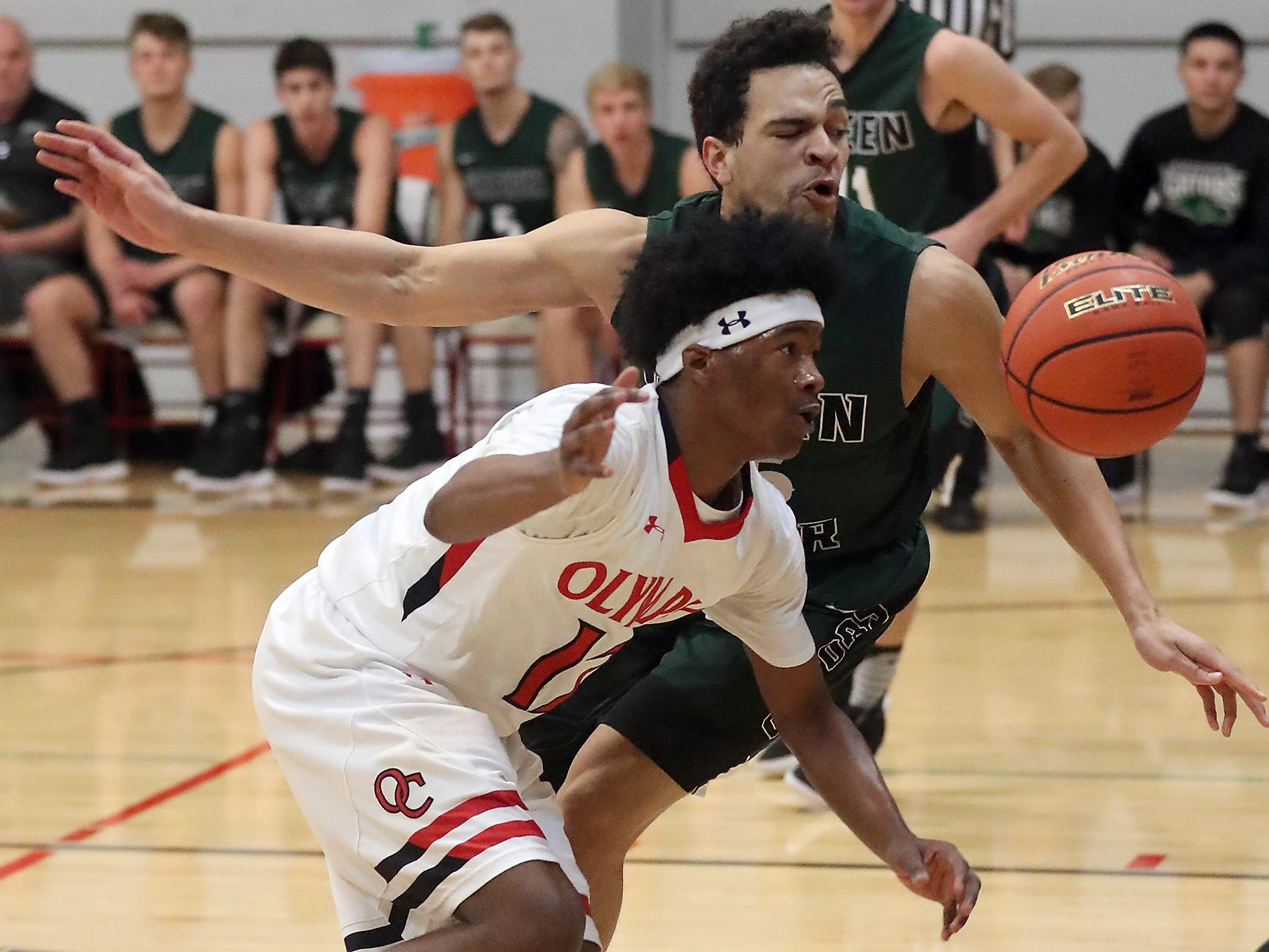 The ball gets out of the control of OC's Markel Banks (front) while Green River's Chayse Mims puts on the pressure at Olympic College in Bremerton on Tuesday, December 11, 2018.