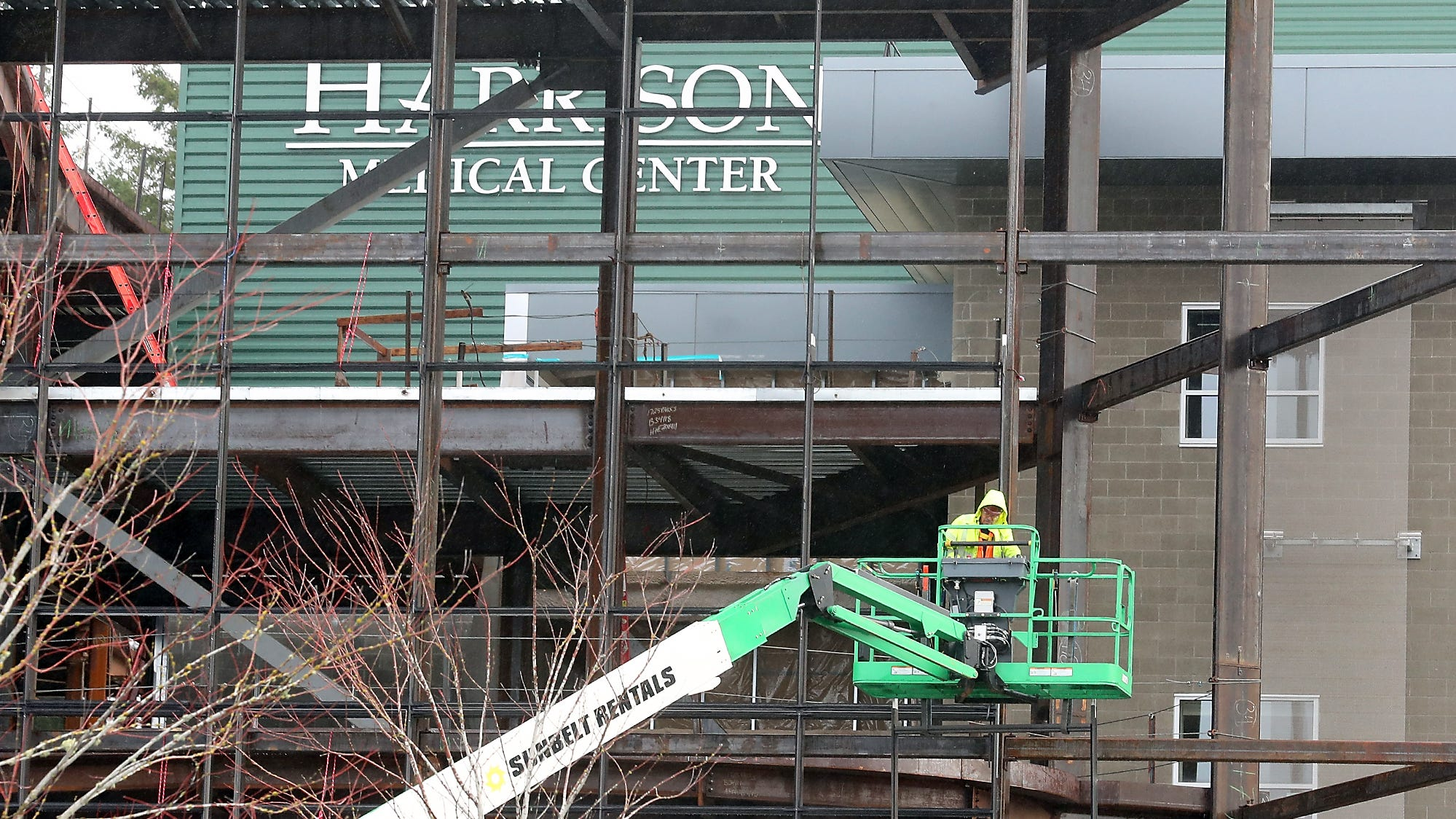 A construction worker operates a lift at Harrison Medical Center in Silverdale on Wednesday, December 12, 2018.