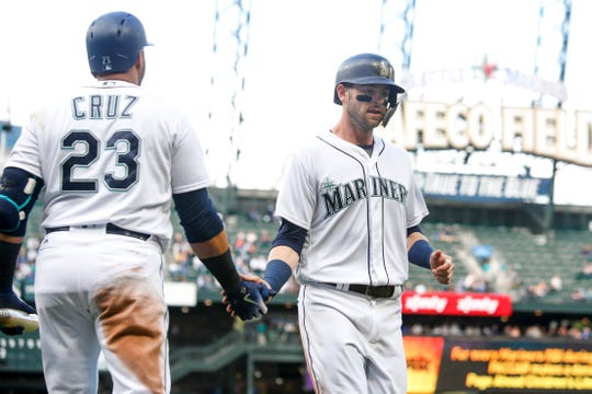 With Nelson Cruz (left) and other veterans headed out of town, younger players like Mitch Haniger (right) will be expected to take enlarged leadership roles with the Mariners. That factor could help keep Haniger in Seattle, despite his obvious trade value.