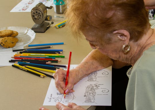 Janice Byrne, 99, colors in thank you cards for the staff at The Brennity in Viera.