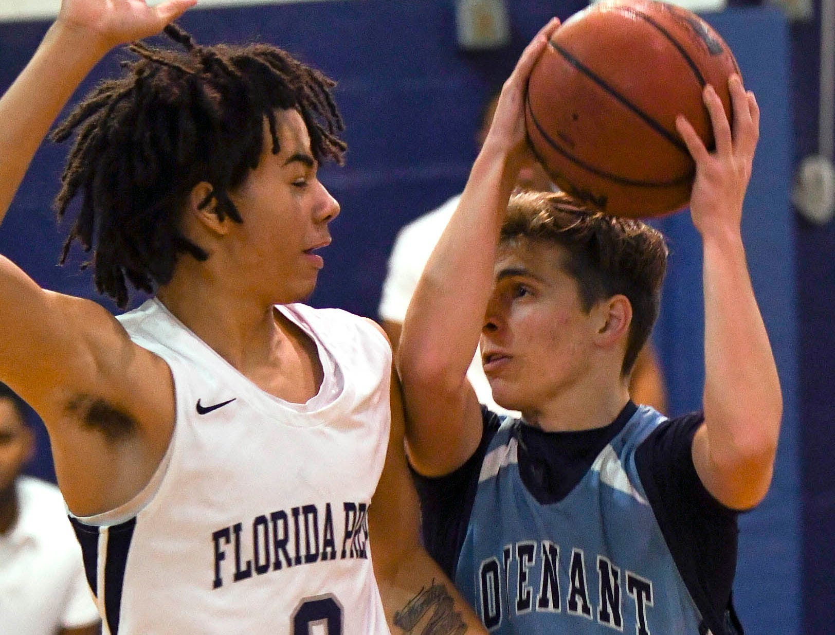 Tre Smith of Florida Prep guards Joseph Cowling of Covenant Christian during Tuesday's game at Florida Prep.