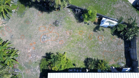 DanWillemin took this drone shot earlier this year (2018), with painted orange polygons showing where a metal detector found buried materials in her yard.