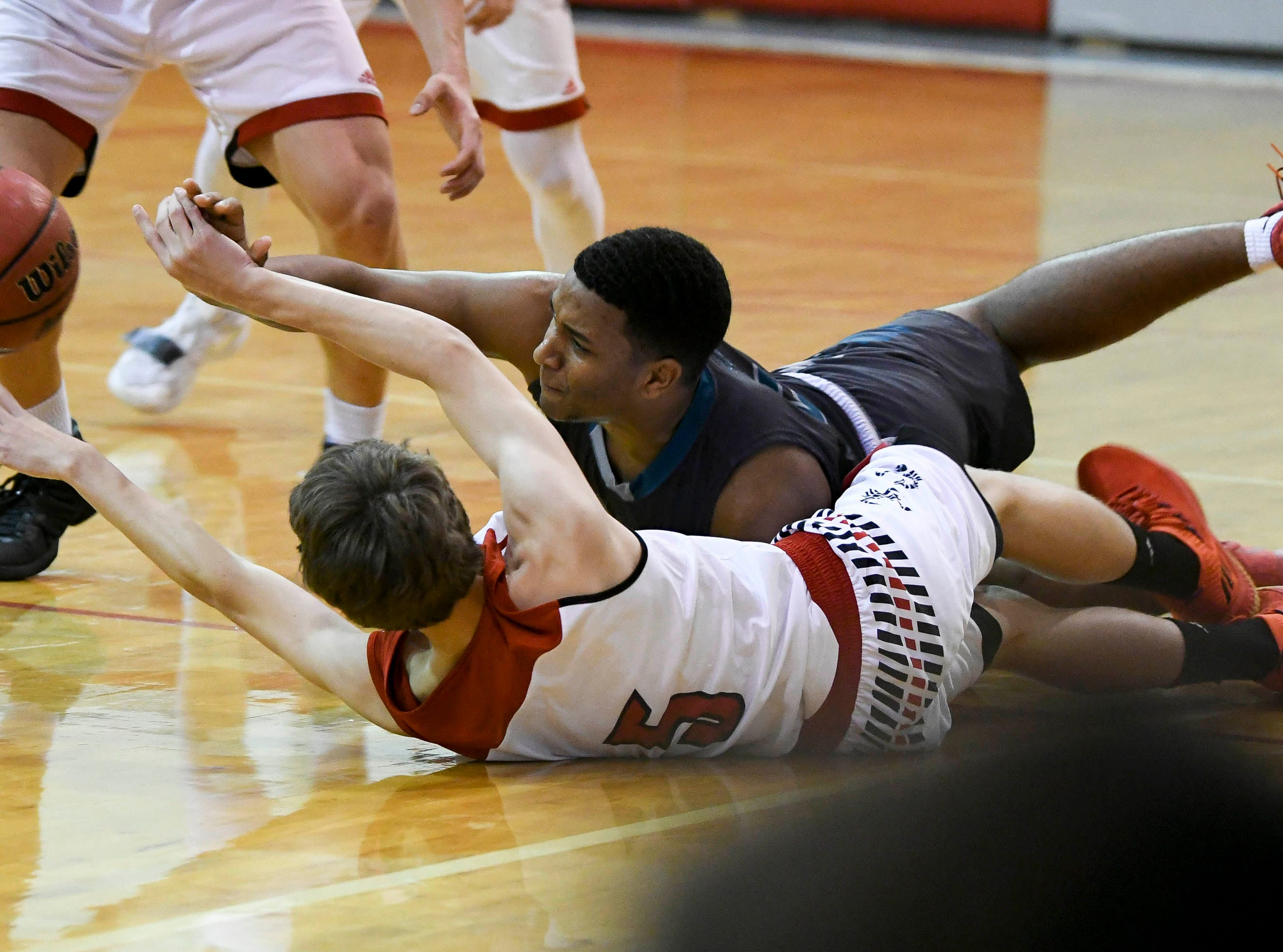 Oliver Pasque of Satellite and Kevin Sanchez of Bayside scramble for a loose ball during Tuesday's game at Satellite High.