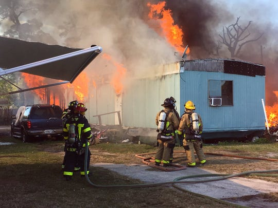 Firefighters battle mobile home fires on Lake Drive in Cocoa area.