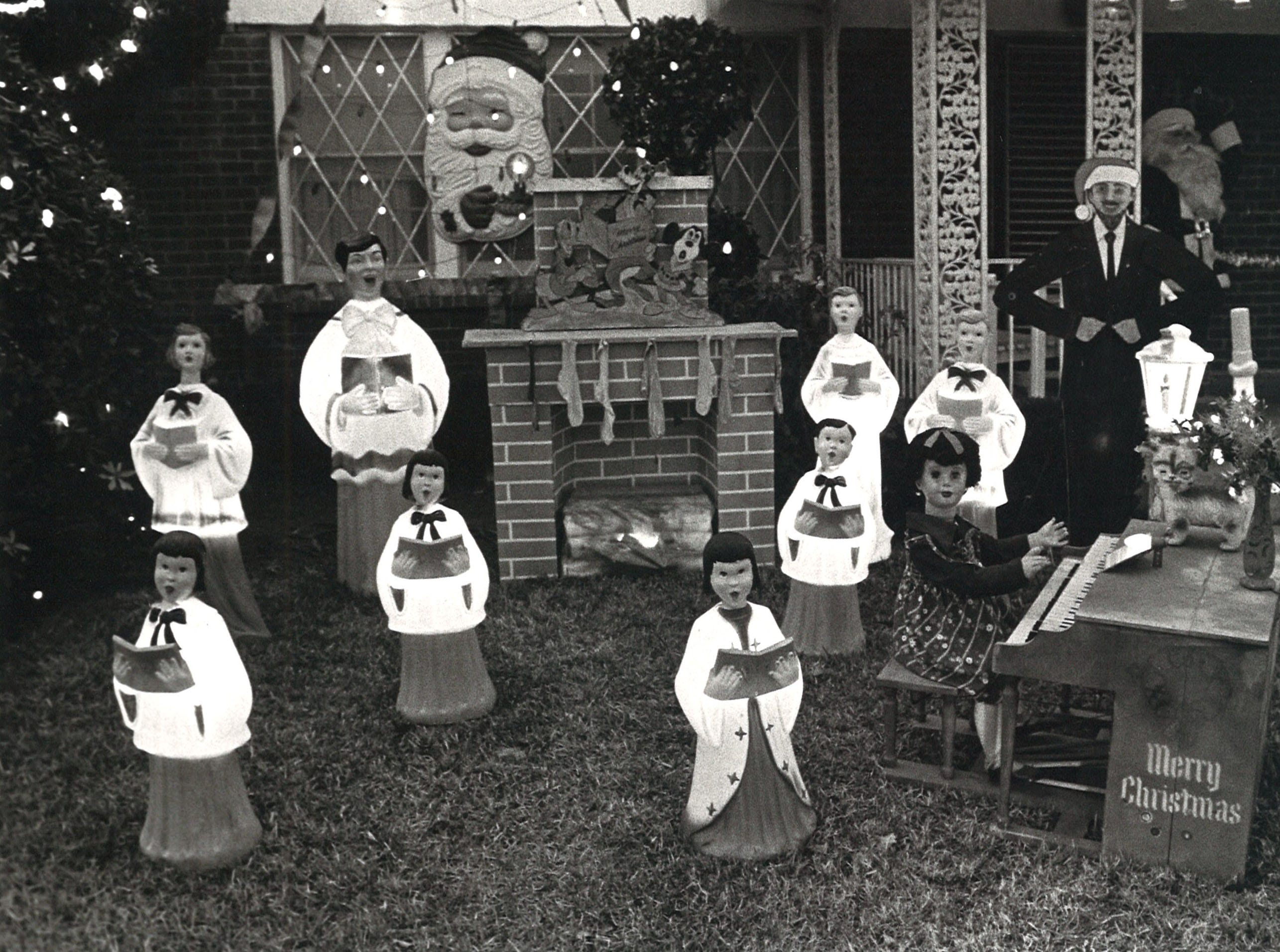 Part of Bill Aldridge's Christmas decorations at his house on the corner of Delaine and Doddridge, seen in this 1980 photo, included a choir.