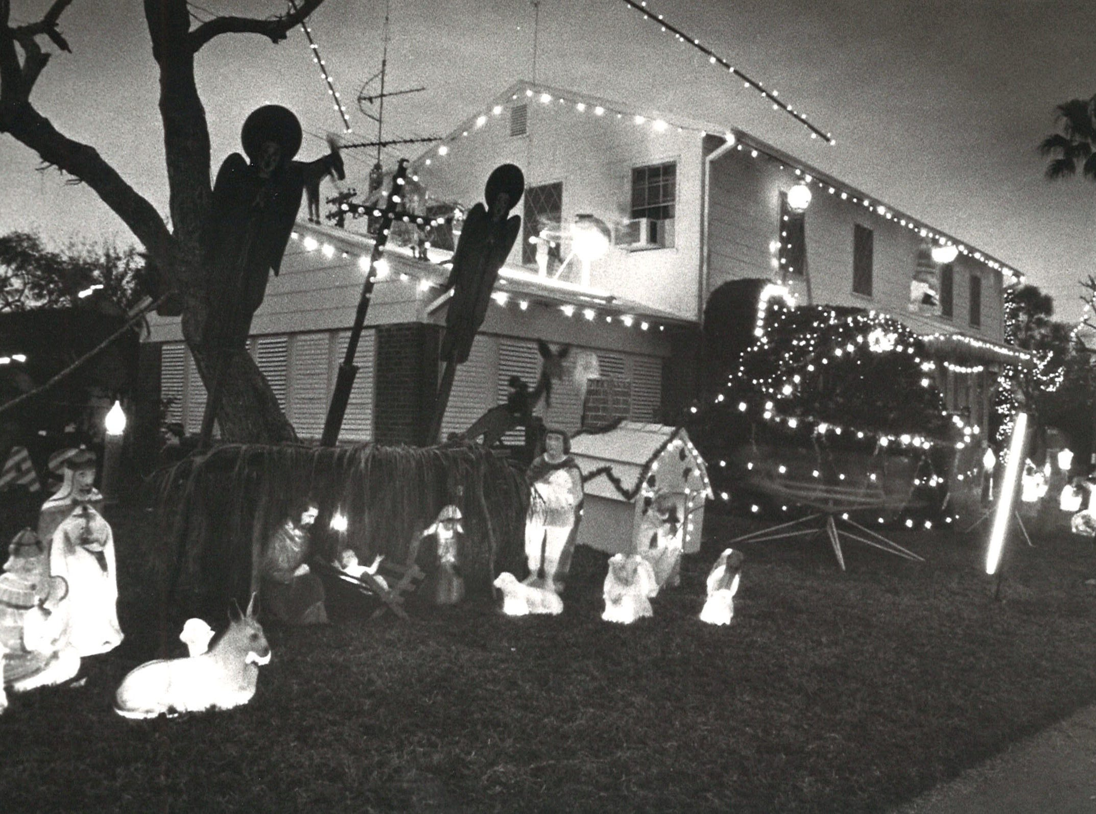 Bill Aldridge decorated his house on the corner of Delaine and Doddridge for more than 30 years. Many of the decorations, seen in this 1980 photo, were built by Alridge, who owned Aldridge TV.