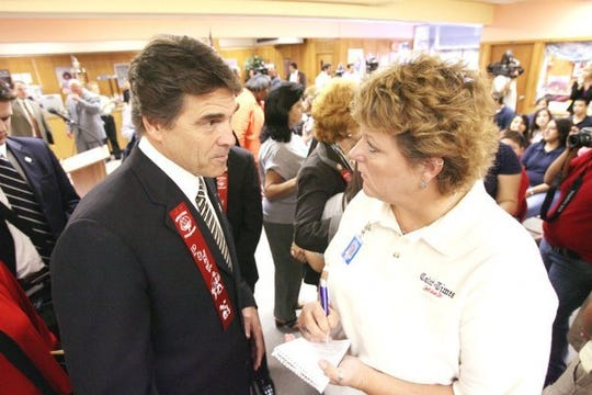 Former Caller-Times politics reporter Jaime Powell interviews then-Gov. Rick Perry. Powell, later known by her married name of Jaime Steindorf, worked for the Corpus Christi Caller-Times in Texas from 2002-2010. She died in 2016.