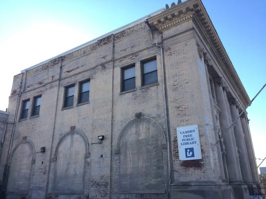 A Philadelphia firm that makes speciality medications is considering a move to a former downtown library in Camden.