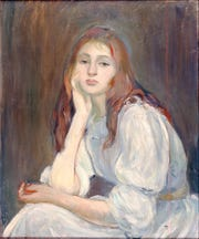 """Portrait of Miss J.(ulie) M.(anet) (Julie Dreaming) (Portrait de Mlle J.(ulie) M.(anet) or Julie Rêveuse),'' was done in 1894. It is an oil on canvas work by Berthe Morisot."