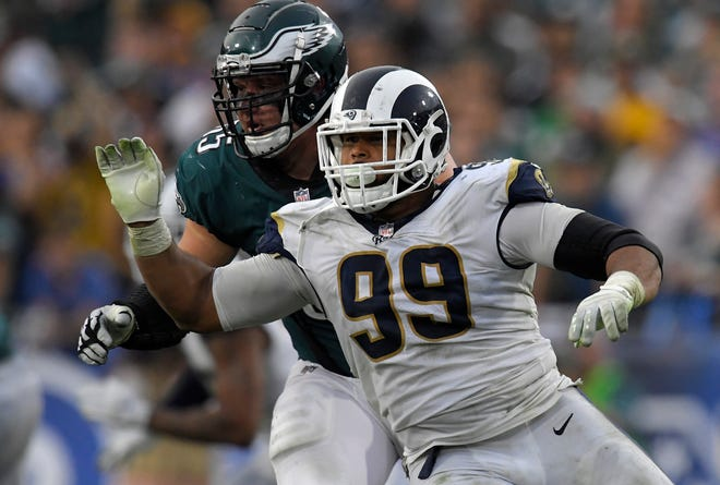 Rams defensive tackle Aaron Donald, right, gets past Eagles offensive tackle Lane Johnson during a game last season.
