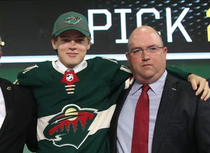 Brent Flahr, right, poses with Minnesota's 2018 first-round pick, Filip Johansson last June.