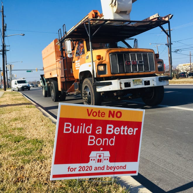 A roadside sign urges defeat of bonds intended to fund school improvements in Cherry Hill.