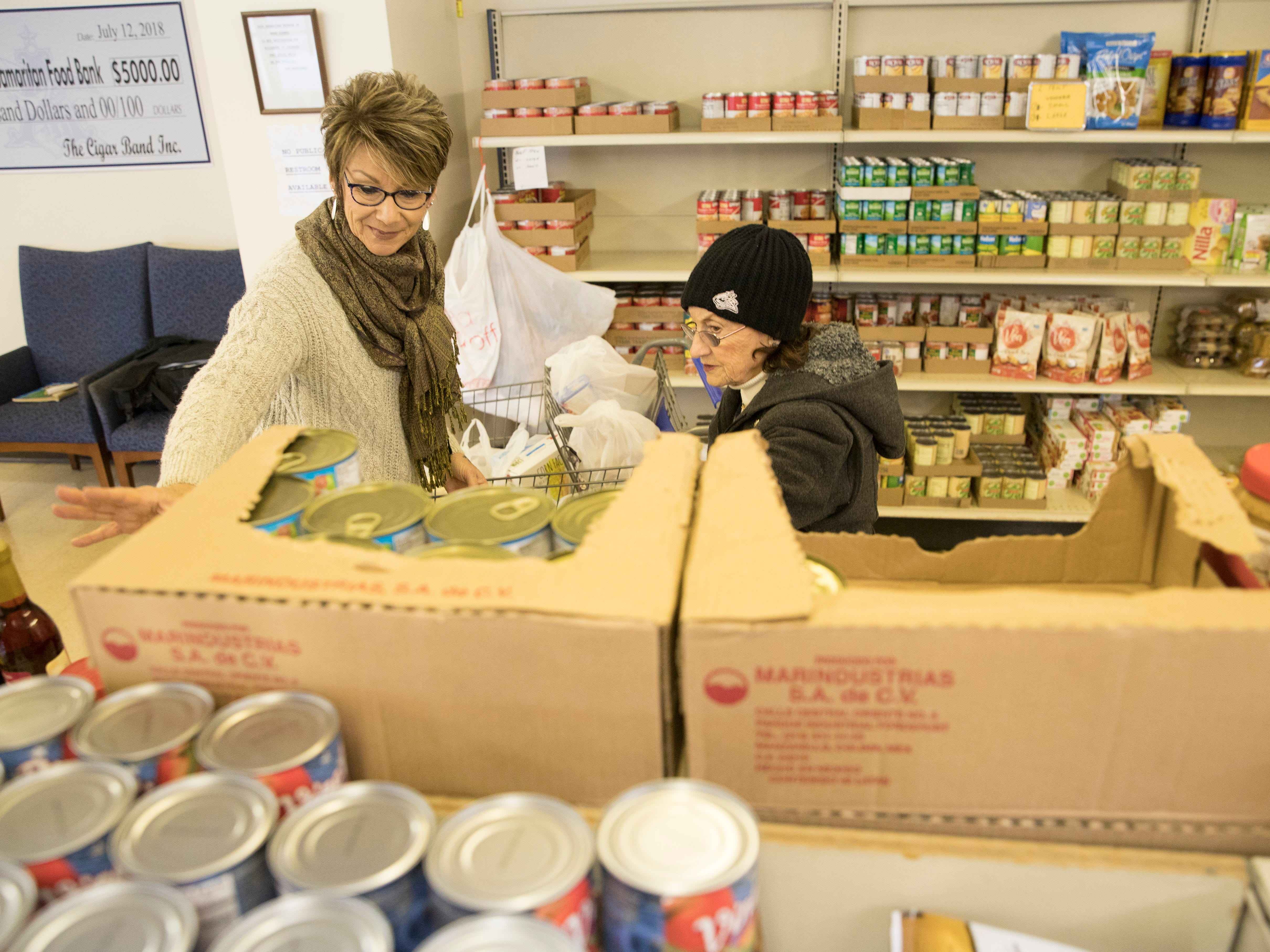 Edie Adkins finishes getting groceries at the Good Samaritan Food Pantry Monday in Chillicothe.