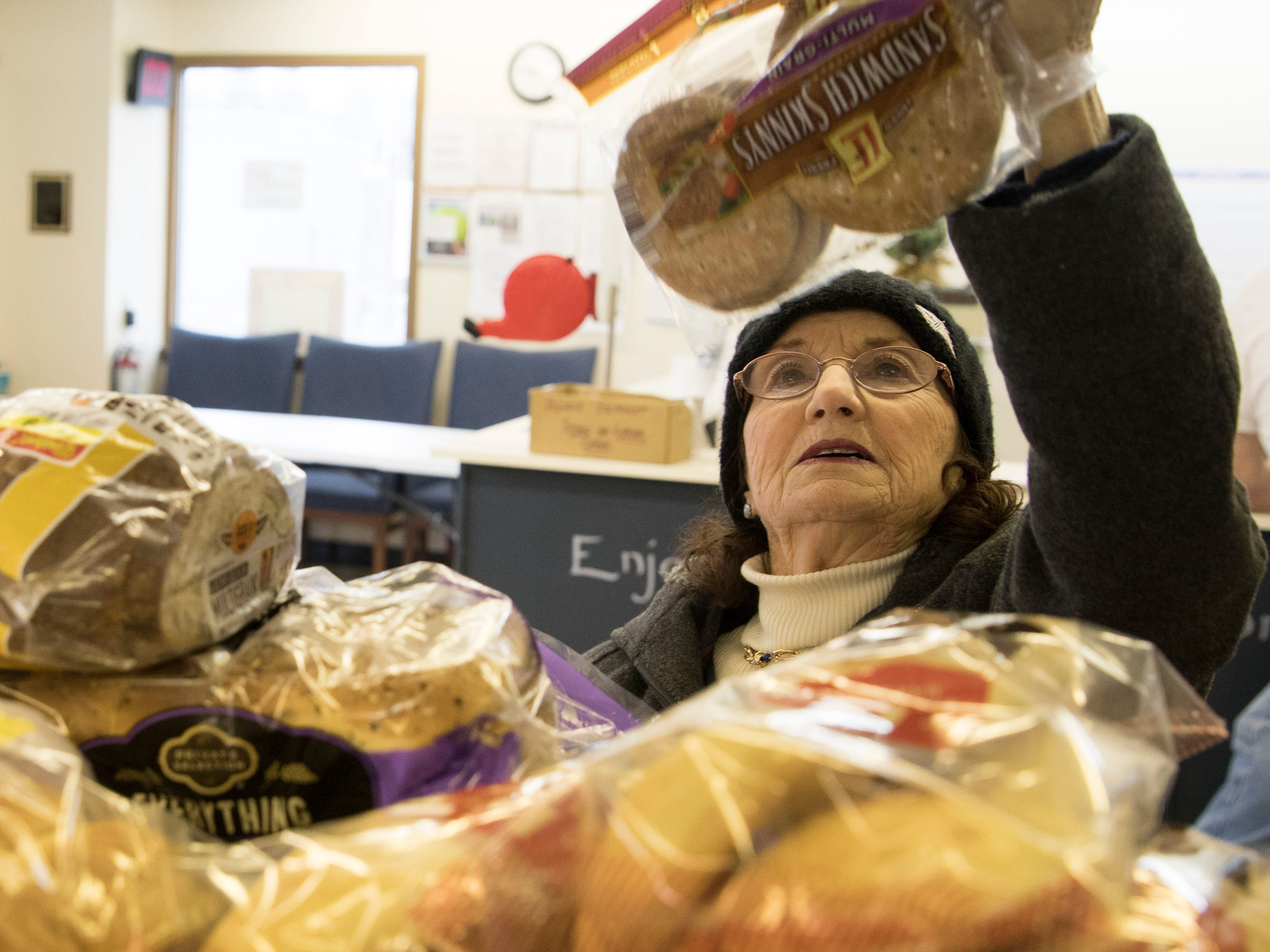 Edie Adkins picks out some bread at the Good Samaritan Food Pantry. Adkins, a 65-year resident of Chillicothe, occasionally comes to the food pantry, especially when she needs money for her bills.