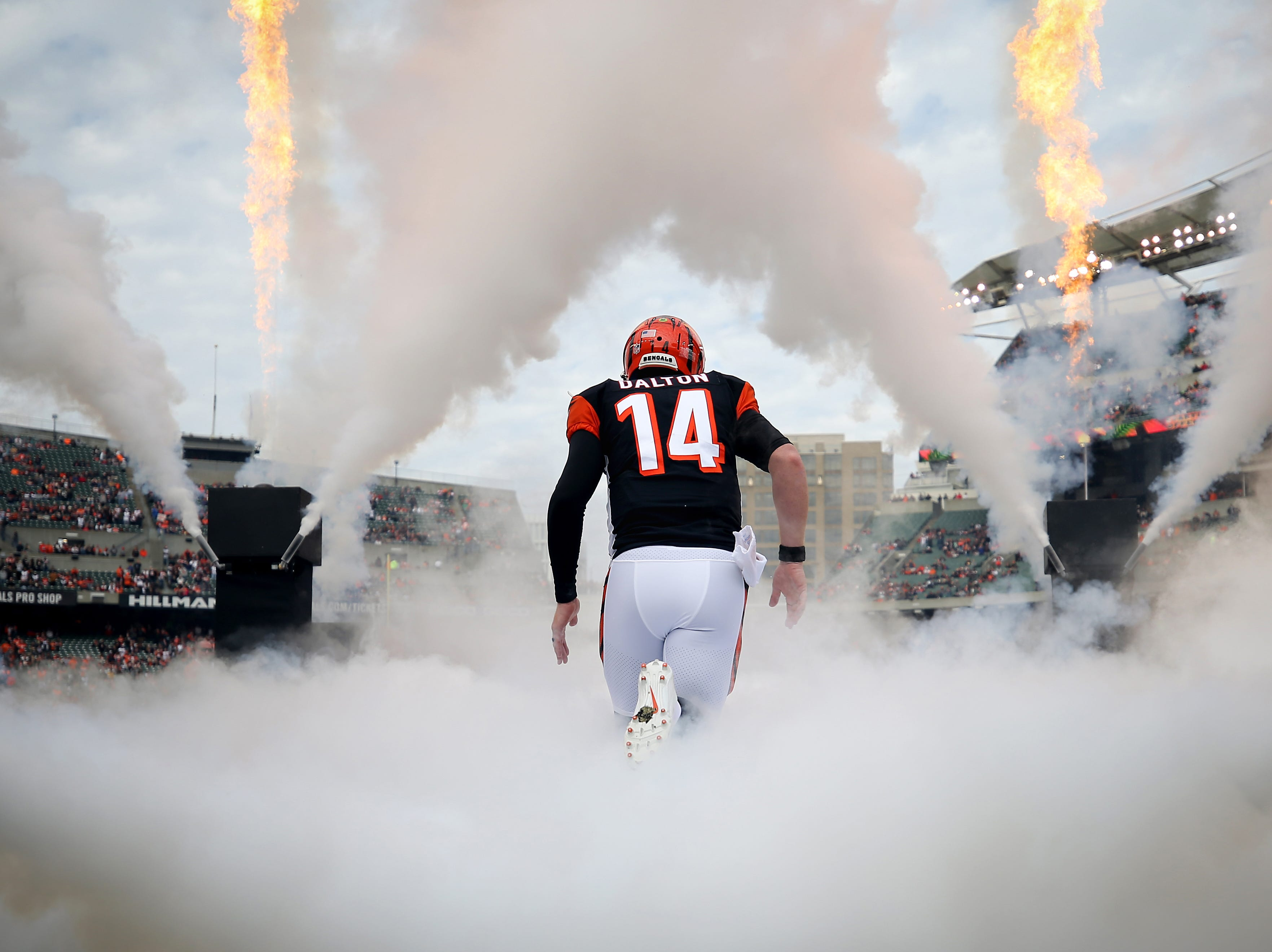 I've been trying to make this photo for a few seasons now, something crisp and iconic of Cincinnati Bengals quarterback Andy Dalton taking the field. The challenge of making this photo, captured before the Week 12 game, is that there are so many people around this area at that moment – other photographers, sideline security, pyrotechnic people and fans with sideline passes. Still, I managed to capture a symmetrical picture of only Dalton.