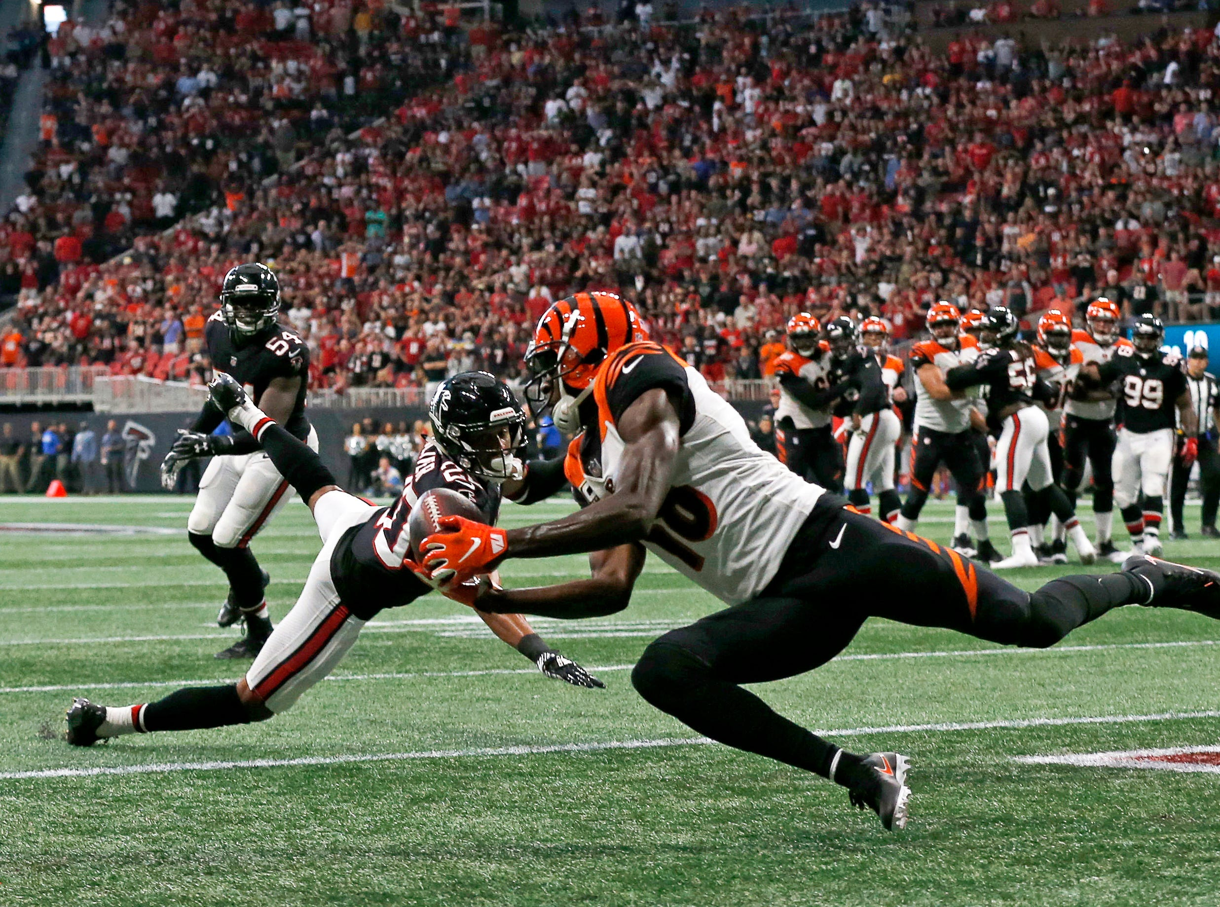 "Maybe the peak moment of this miserable Bengals season (for the team and for me as a photographer) was A.J. Green's game-winning catch at the end of the game in Atlanta. With the game on the line, I knew as well as the team did that the entire day was possibly going to be summed up in one moment. With the pressure on, Andy Dalton and Green managed to pull off a stunning pass, and I was thankfully right where I needed to be to capture it. They say ""luck is where opportunity meets preparation"" and this was one of those instances. It seems that whether you're a quarterback or a photographer, you can always count on Green.  Cincinnati Bengals wide receiver A.J. Green (18) catches the game-winning touchdown pass with seven seconds remaining in the fourth quarter of the NFL Week 4 game between the Atlanta Falcons and the Cincinnati Bengals at Mercedes-Benz Stadium in Atlanta on Sunday, Sept. 30, 2018. The Bengals scored a touchdown in the final seconds of the fourth quarter to win 37-36."