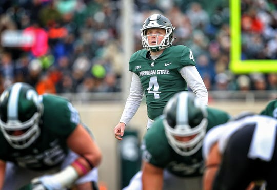 Oct 27, 2018; East Lansing, MI, USA; Michigan State Spartans place kicker Matt Coghlin (4) prepares to kick a field goal during the second half of a game against the Purdue Boilermakers at Spartan Stadium.