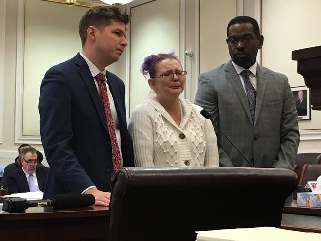 Jessica Hayes, at center, cries during her sentencing Wednesday in Hamilton County Common Pleas Court. Hayes' attorneys, Rodney Harris, at right, and Justin Carmichael, stand beside her. Judge Jody Luebbers sentenced Hayes to five years in prison. She pleaded guilty to involuntary manslaughter in the death of her 6-month-old daughter who overdosed on fentanyl.