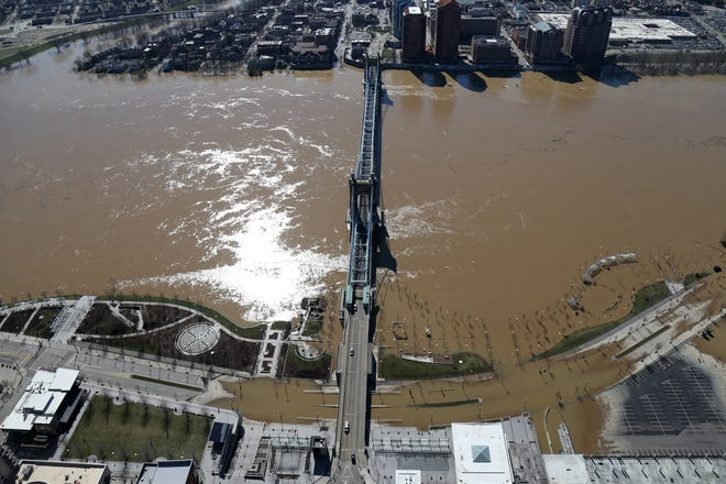 Documenting important events that affect the life of my neighbors is one of the most important tasks of a photojournalist. When the region experienced some of the worst flooding in years, I was asked to fly in a helicopter and capture images from above. In this aerial photograph of a flooded Smale Riverfront Park, water breached the banks of the swollen Ohio River, Monday, Feb. 26, 2018.
