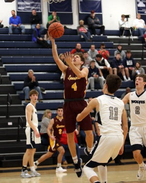 Turpin guard Dominic Cantrella scores during a Spartan fast break. Turpin defeated West Clermont 70-51.